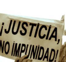 """Pancarte de una protesta popular en la que se puede leer """"Â¡Juastica No Impunidad!"""