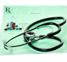 Factura médica, fonendoscopio y pastillas
